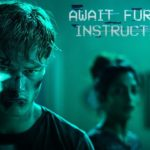 Await Further Instructions – Tráiler